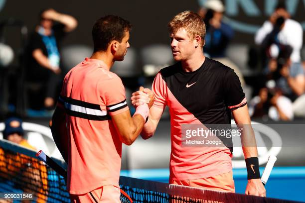 Grigor Dimitrov of Bulgaria congratulates Kyle Edmund of Great Britain after Edmund won their quarterfinal match against on day nine of the 2018...