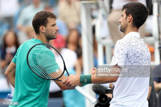 Grigor Dimitrov of Bulgaria congratulates Novak Djokovic of Serbia during the Western Southern Open at Lindner Family Tennis Center on August 17 2018...
