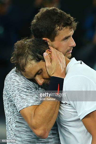 Grigor Dimitrov of Bulgaria congratulates Rafael Nadal of Spain on winning their semifinal match on day 12 of the 2017 Australian Open at Melbourne...