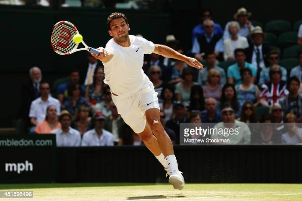 Grigor Dimitrov of Bulgaria during his Gentlemen's Singles quarterfinal match against Andy Murray of Great Britain on day nine of the Wimbledon Lawn...