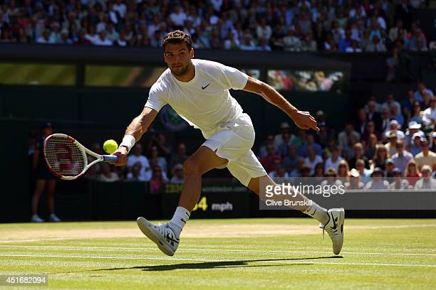 Grigor Dimitrov of Bulgaria during his Gentlemen's Singles semifinal match against Novak Djokovic of Serbia on day eleven of the Wimbledon Lawn...