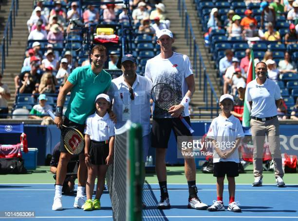 Grigor Dimitrov of Bulgaria gather for the coin toss with Kevin Anderson of South Africa prior to their quarter final match on Day 5 of the Rogers...
