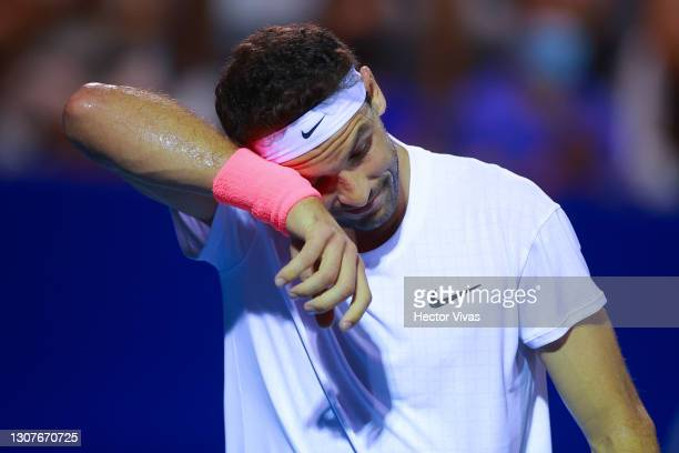 Grigor Dimitrov of Bulgaria gestures during the match between Miomir Kecmanovic of Serbia and Grigor Dimitrov of Bulgaria as part of the Telcel...