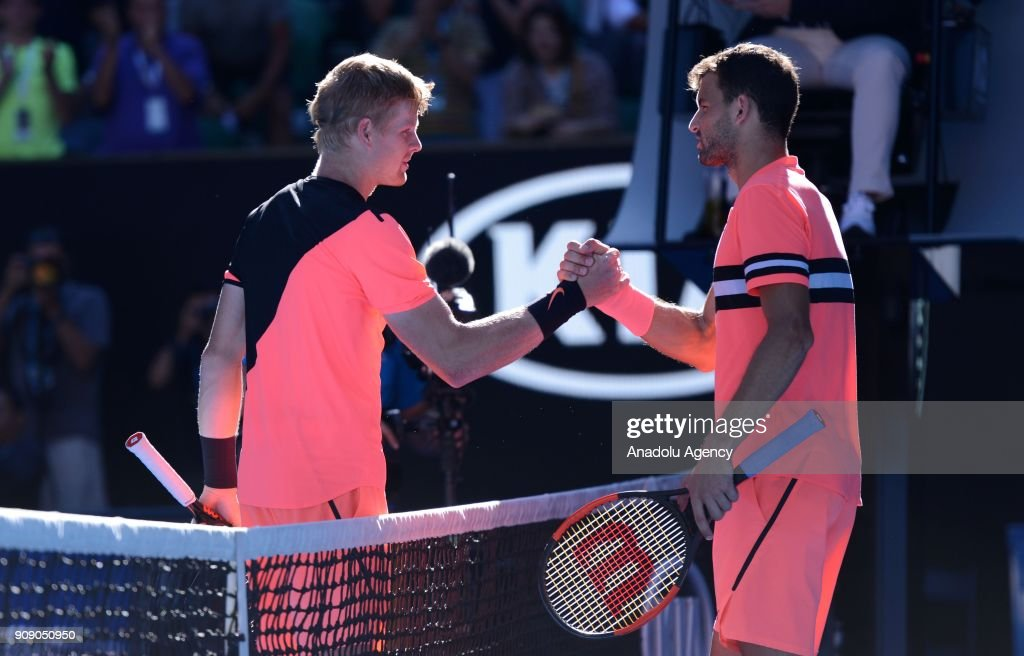 Grigor Dimitrov (R) of Bulgaria greets Kyle Edmund (L) of United Kingdom during the ninth day of 2018 Australia Open tennis tournament at Melbourne Park in Melbourne, Australia on January 23, 2018.