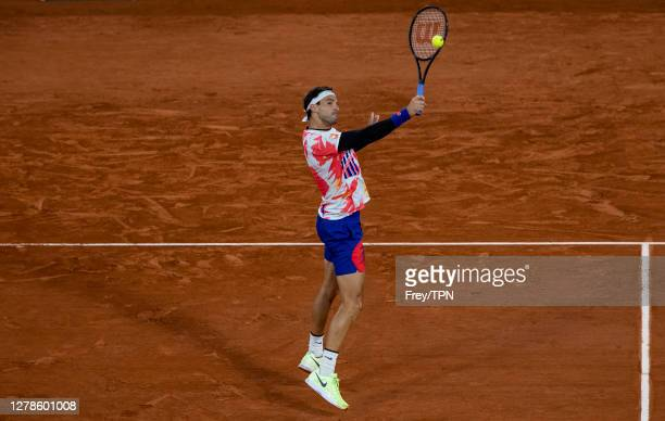 Grigor Dimitrov of Bulgaria hits a backhand against Stefanos Tsitsipas of Greece in the fourth round of the men's singles at Roland Garros on October...