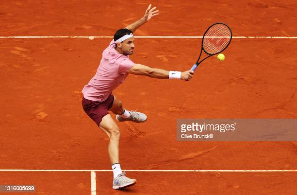 Grigor Dimitrov of Bulgaria hits a backhand during his match against Lloyd Harris of South Africa at La Caja Magica on May 03, 2021 in Madrid, Spain.