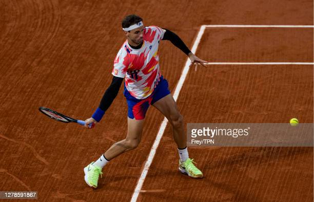Grigor Dimitrov of Bulgaria hits a forehand against Stefanos Tsitsipas of Greece in the fourth round of the men's singles at Roland Garros on October...