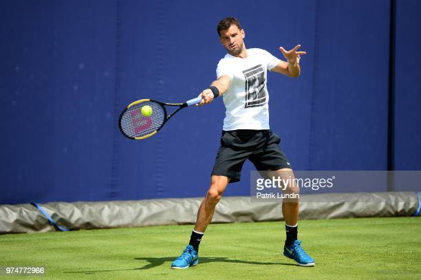 Grigor Dimitrov of Bulgaria hits a forehand during practice with Kyle Edmund of Great Britain during preevent Day 1 of the FeverTree Championships at...