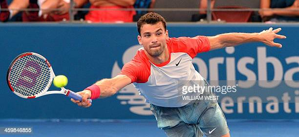 Grigor Dimitrov of Bulgaria hits a forehand return to Marin Cilic of Croatia at the Brisbane International tennis tournament in Brisbane on January 1...