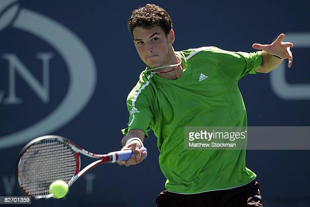 Grigor Dimitrov of Bulgaria hits a forehand to Devin Britton of the United States in the boy's singles final on Day 14 of the 2008 US Open at the...
