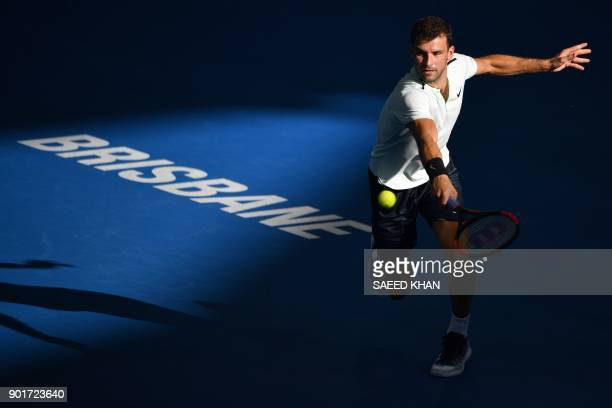 TOPSHOT Grigor Dimitrov of Bulgaria hits a return to Nick Kyrgios of Australia during their men's singles semifinal match at the Brisbane...
