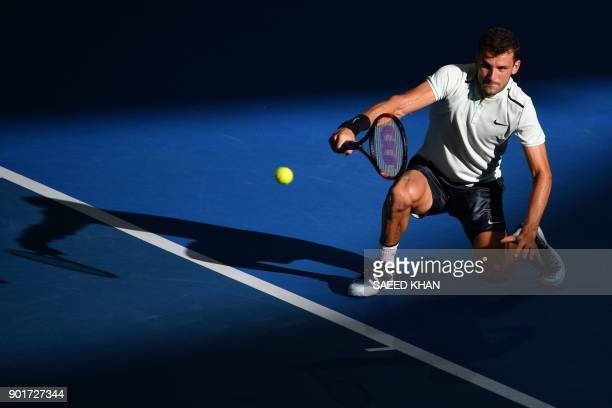 Grigor Dimitrov of Bulgaria hits a return to Nick Kyrgios of Australia during their men's singles semifinal match at the Brisbane International...