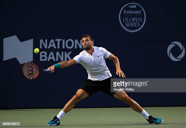 Grigor Dimitrov of Bulgaria hits a shot against Denis Shapovalov of Canada on Day 3 of the Rogers Cup at the Aviva Centre on July 27 2016 in Toronto...