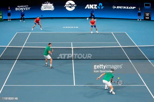 Grigor Dimitrov of Bulgaria hits a volley during the doubles game on day three of the Group C singles match at the 2020 ATP Cup Tennis at Ken...