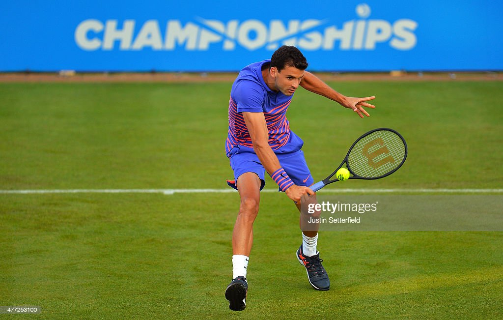 Grigor Dimitrov of Bulgaria hits a volley in his men's singles first round match against Sam Querrey of USA during day one of the Aegon Championships at Queen's Club on June 15, 2015 in London, England.