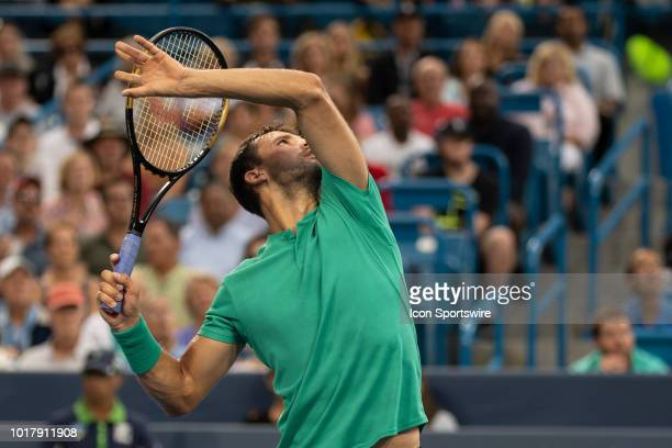 Grigor Dimitrov of Bulgaria hits an overhead to Novak Djokovic of Serbia during Day 5 of the Western and Southern Open at the Lindner Family Tennis...
