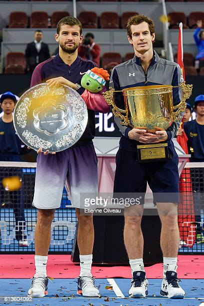 Grigor Dimitrov of Bulgaria holds the runner up trophy while Andy Murray of Great Britain holds the winners trophy after winning the Women's Singles...