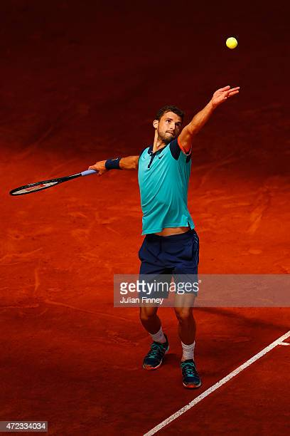 Grigor Dimitrov of Bulgaria in action against Fabio Fognini of Italy during day five of the Mutua Madrid Open tennis tournament at the Caja Magica on...