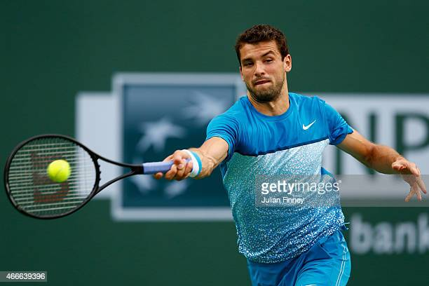 Grigor Dimitrov of Bulgaria in action against Tommy Robredo of Spain during day nine of the BNP Paribas Open tennis at the Indian Wells Tennis Garden...
