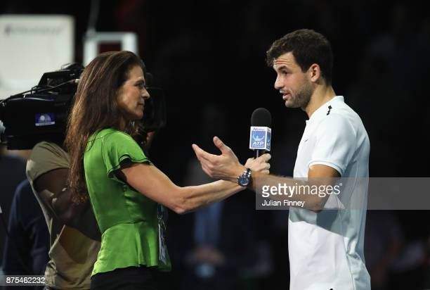 Grigor Dimitrov of Bulgaria is interviewed by Annabel Croft after his Singles match against Pablo Carreno Busta of Spain during day six of the Nitto...
