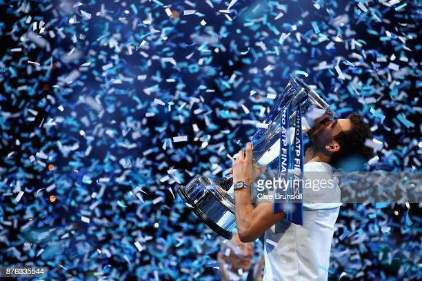 Grigor Dimitrov of Bulgaria kisses the trophy as he celebrates victory during the singles final against David Goffin of Belgium during day eight of...
