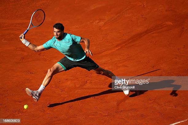Grigor Dimitrov of Bulgaria leaps to play a forehand against Marcos Baghdatis of Cyprus in their first round match during day one of the...