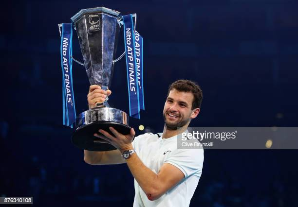 Grigor Dimitrov of Bulgaria lifts the trophy as he celebrates victory following the singles final against David Goffin of Belgium during day eight of...