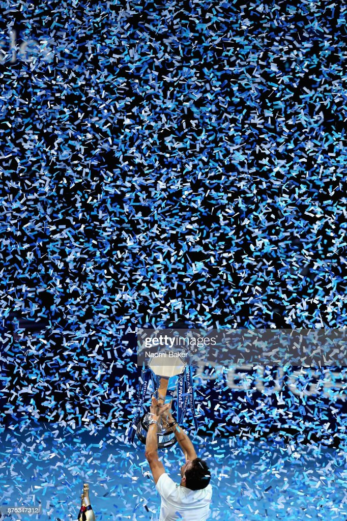 Grigor Dimitrov of Bulgaria lifts the trophy following victory in the mens singles final against David Goffin of Belgium during day eight of the 2017 Nitto ATP World Tour Finals at O2 Arena on November 19, 2017 in London, England.