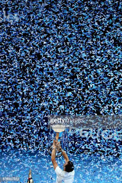 Grigor Dimitrov of Bulgaria lifts the trophy following victory in the mens singles final against David Goffin of Belgium during day eight of the 2017...