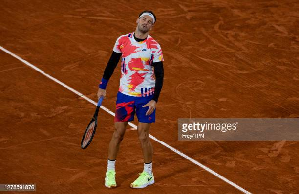 Grigor Dimitrov of Bulgaria looks dejected during his match against Stefanos Tsitsipas of Greece in the fourth round of the men's singles at Roland...