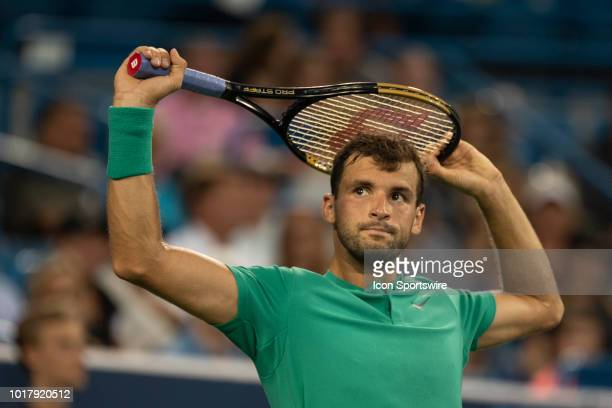 Grigor Dimitrov of Bulgaria looks up to watch hawk eye during Day 5 of the Western and Southern Open at the Lindner Family Tennis Center on August 16...