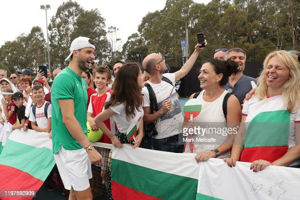 Grigor Dimitrov of Bulgaria meets Bulgarian fans during day three of the 2020 ATP Cup Group Stage at Ken Rosewall Arena on January 05 2020 in Sydney...