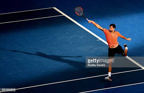 Grigor Dimitrov of Bulgaria plays a backhand against Dominic Thiem of Austria on day six of the 2017 Brisbane International at Pat Rafter Arena on...