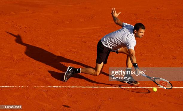 Grigor Dimitrov of Bulgaria plays a backhand against Matteo Berrettini of Italy in their first round match during Day One of the Rolex MonteCarlo...
