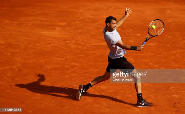 Grigor Dimitrov of Bulgaria plays a backhand against Rafael Nadal of Spain in their third round match during day five of the Rolex MonteCarlo Masters...