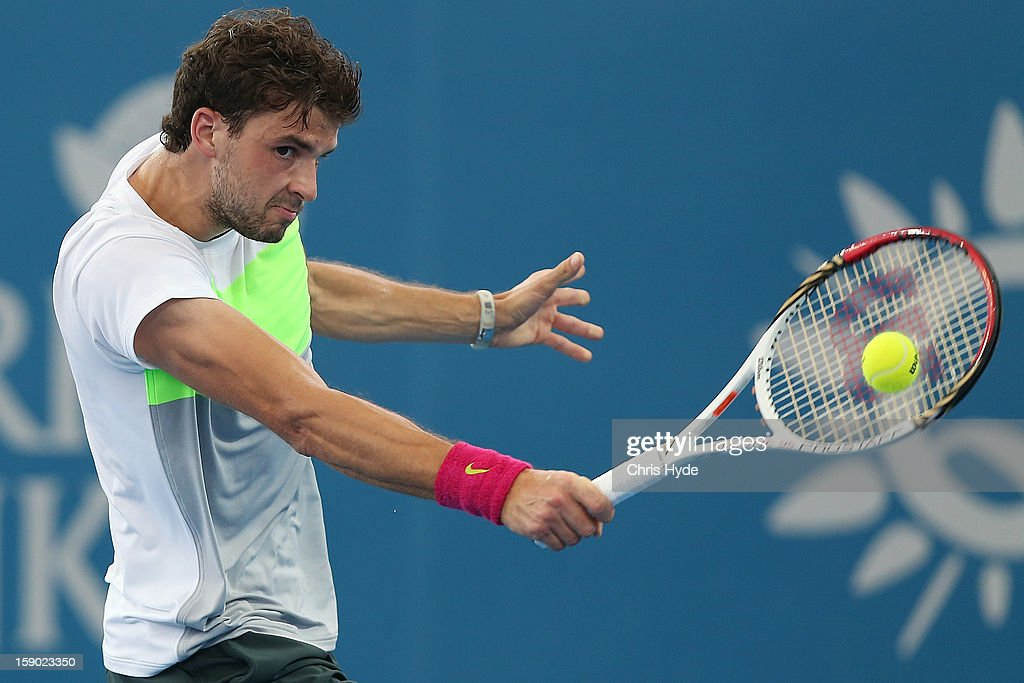 Grigor Dimitrov of Bulgaria plays a backhand during his final match against Andy Murray of Great Britain on day eight of the Brisbane International at Pat Rafter Arena on January 6, 2013 in Brisbane, Australia.
