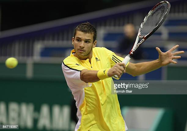 Grigor Dimitrov of Bulgaria plays a backhand during his match against Tomas Berdych of Czech Republic during day two of the ABN AMRO World Tennis...