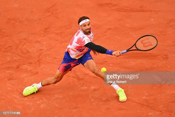 Grigor Dimitrov of Bulgaria plays a backhand during his Men's Singles second round match against Andrej Martin of Slovakia on day five of the 2020...