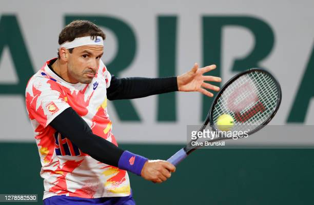 Grigor Dimitrov of Bulgaria plays a backhand during his Men's Singles fourth round match against Stefanos Tsitsipas of Greece on day nine of the 2020...