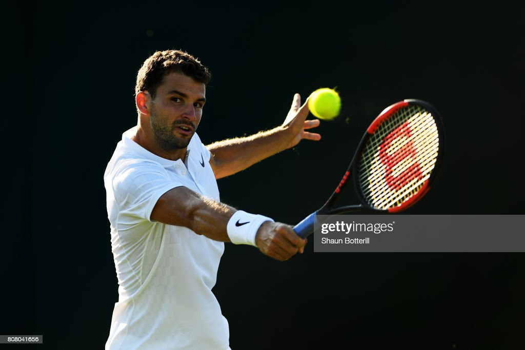 Grigor Dimitrov of Bulgaria plays a backhand during the Gentlemen's Singles first round match against Diego Schwartzman of Argentina on day two of the Wimbledon Lawn Tennis Championships at the All England Lawn Tennis and Croquet Club on July 4, 2017 in London, England.