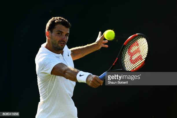 Grigor Dimitrov of Bulgaria plays a backhand during the Gentlemen's Singles first round match against Diego Schwartzman of Argentina on day two of...