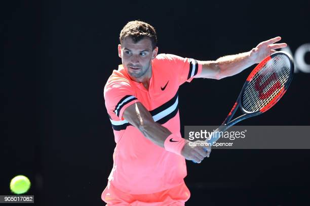 Grigor Dimitrov of Bulgaria plays a backhand in his first round match against Dennis Novak of Austria on day one of the 2018 Australian Open at...