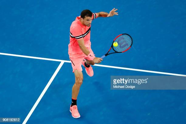 Grigor Dimitrov of Bulgaria plays a backhand in his fourth round match against Nick Kyrgios of Australia on day seven of the 2018 Australian Open at...