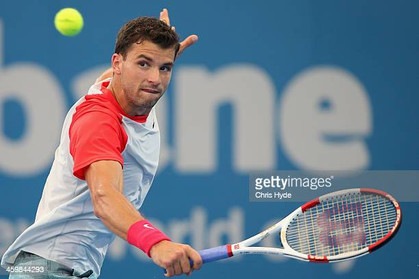 Grigor Dimitrov of Bulgaria plays a backhand in his match against Marin Cilic of Croatia during day four of the 2014 Brisbane International at...