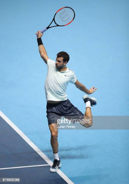 Grigor Dimitrov of Bulgaria plays a backhand in his match against Jack Sock of USA in the semi finals during day seven of the Nitto ATP World Tour...