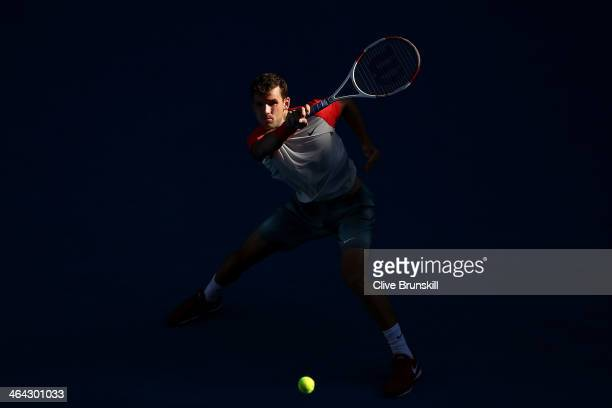 Grigor Dimitrov of Bulgaria plays a backhand in his quarterfinal match against Rafael Nadal of Spain during day 10 of the 2014 Australian Open at...