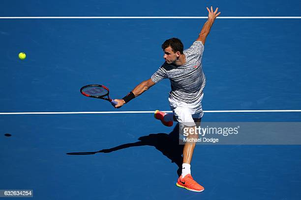Grigor Dimitrov of Bulgaria plays a backhand in his quarterfinal match against David Goffin of Belgium on day 10 of the 2017 Australian Open at...