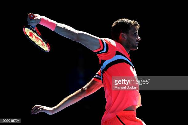 Grigor Dimitrov of Bulgaria plays a backhand in his quarterfinal match against Kyle Edmund of Great Britain on day nine of the 2018 Australian Open...