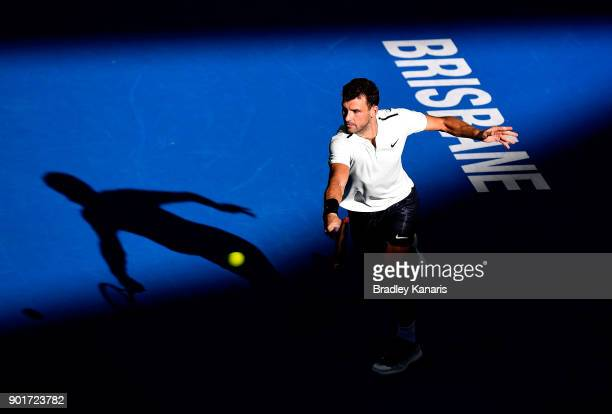 Grigor Dimitrov of Bulgaria plays a backhand in his semi final match against Nick Kyrgios of Australia during day seven of the 2018 Brisbane...