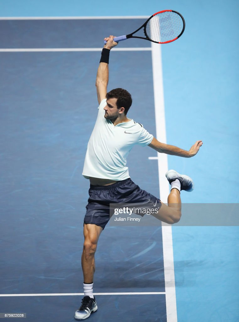 Grigor Dimitrov of Bulgaria plays a backhand in his Singles Semi Final match against Jack Sock of the United States during day seven of the Nitto ATP World Tour Finals at O2 Arena on November 18, 2017 in London, England.